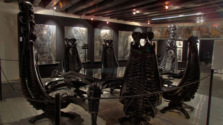 Giger's amazing Harkonnen table set, surrounded by his surreal paintings